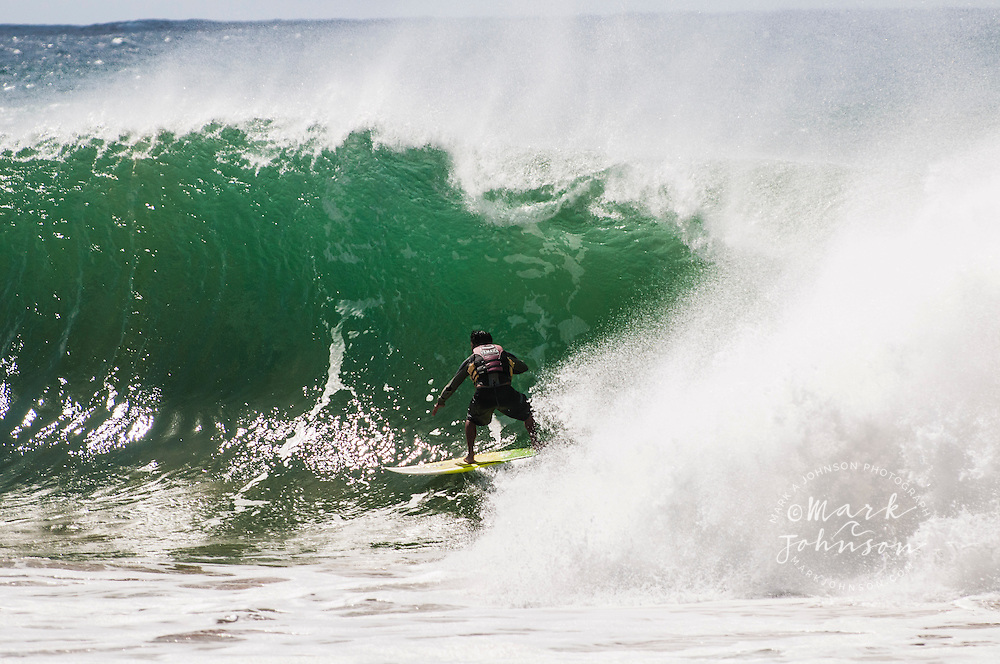 Surfer pulling into a tube, Hawaii