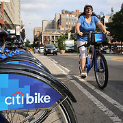 A Citi Bike docking station in Union Square, Manhattan, New York. Citi Bike the NYC Bicycle Share Program sponsored by Citi Bank, launched in late May 2013 giving access to thousands of bikes at docking stations throughout  Manhattan and parts of Brooklyn. Manhattan, New York, USA. 24th July 2013. Photo Tim Clayton