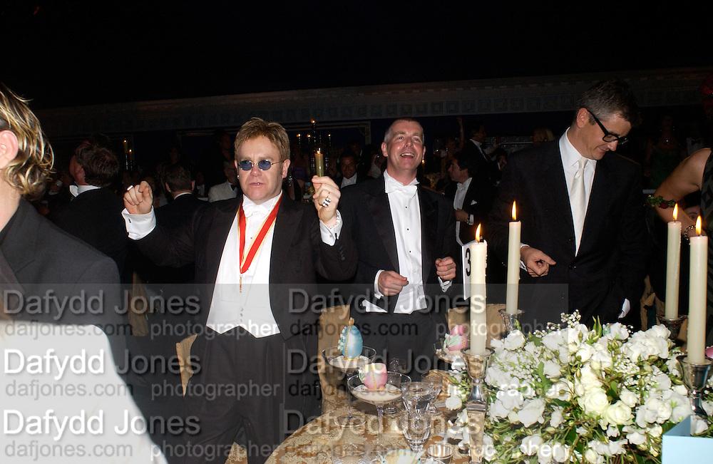 Sir Elton John, Neil Tennant and Jay Jopling, Sir Elton John's White Tie and Tiara Ball. Windsor, 28 June 2003. © Copyright Photograph by Dafydd Jones 66 Stockwell Park Rd. London SW9 0DA Tel 020 7733 0108 www.dafjones.com
