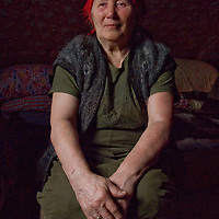 77-year old Marie Terentéva, a member of the last nomadic Komi reindeer herding clan, relaxes in her cozy chum (tepee), which is much warmer than sub-freezing temperatures outside, north of the Arctic Circle in Russia.