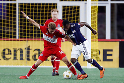 September 22, 2018 - Foxborough, MA, U.S. - FOXBOROUGH, MA - SEPTEMBER 22: Chicago Fire midfielder Djordje Mihailovic (14) holds off New England Revolution forward Cristian Penilla (70) during a match between the New England Revolution and the Chicago Fire on September 22, 2018, at Gillette Stadium in Foxborough, Massachusetts. The teams played to a 2-2 draw. (Photo by Fred Kfoury III/Icon Sportswire) (Credit Image: © Fred Kfoury Iii/Icon SMI via ZUMA Press)