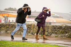 © Licensed to London News Pictures. 09/02/2020. Porthcawl, Bridgend, Wales, UK. People battle against severe gale force winds and blinding rain at Trecco Bay in the Welsh seaside resort of Porthcawl in Bridgend, UK. Photo credit: Graham M. Lawrence/LNP