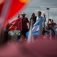 Mel Zelaya and Salvador Nasralla speak to crowds during a demonstration against electoral fraud in Tegucigalpa.