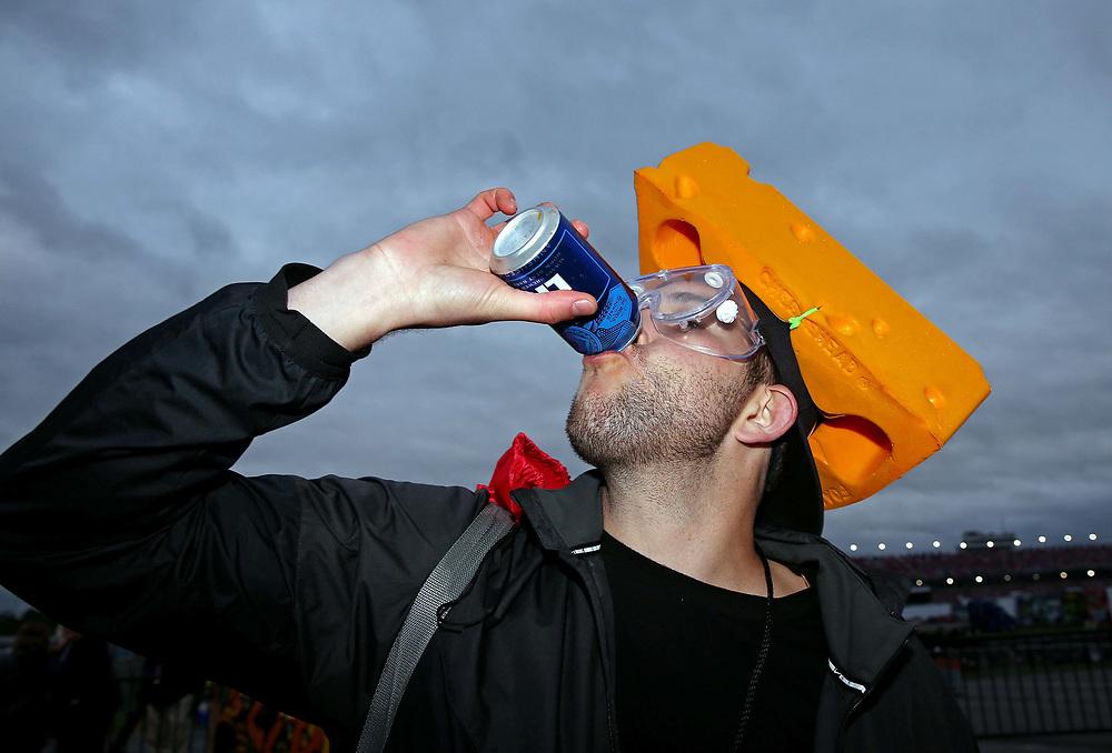 May 5, 2017; Talladega, AL, USA; Mike Simpson drinks a beer during the Talladega Blvd Parade at Talladega Superspeedway. Mandatory Credit: Peter Casey-USA TODAY Sports