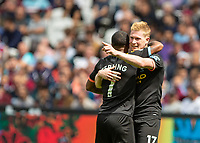 Football - 2019 / 2020 Premier League - West Ham United vs. Manchester City<br /> <br /> Kevin De Bruyne (Manchester City) points to the assist provider as he congratulates scorer Raheem Sterling (Manchester City) at the London Stadium<br /> <br /> COLORSPORT/DANIEL BEARHAM