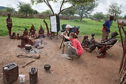 Peter Menzel and Faith D'Aluisio co-authors of the book What I Eat: Around the World in 80 Diets, interview Viahondjera Musutua, a 23 year old Himba woman in the small village of Okapembambu in northwestern Namibia. The young woman is the mother of three children and bore her first child at age 14.  The Himba culture is polygamous and Viahondjera is the second wife of her husband. Like most traditional Himba women, she covers herself from head to toe with an ochre powder, cow butter blend.