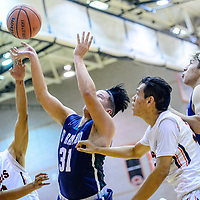 Gallup Bengal Asa Holyan (42), left, chases Rio Rancho Ram Derrick Reyes (31) to the basket as Bengal Josh Lynch (33), and Ram Blaine Gallegos (35) look on at Gallup High School Tuesday.
