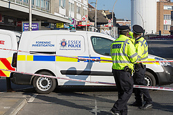 A police cordon is in place where a man alleged by witnesses to be a drug dealer was stabbed to death outside Ilford Station following a fight outside a Paddy Power betting shop 100 yards away on Ilford High Road. London, February 27 2019.