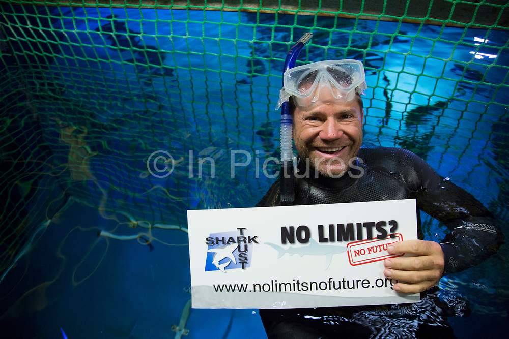 10th July 2014 London: As an ambassador for the Shark Trust's No Limits? campaign, Steve Backshall takes the plunge with the sharks at SEA LIFE London Aquarium, demonstrating that their fearsome reputation is often misplaced and that focus should in fact be on the escalating scale of unmanaged shark fishing. www.sharktrust.org