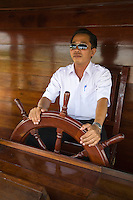 Riverboat Captain piloting Le Bassac on the Mekong River -  Le Bassac travels along the Mekong and pokes around the Mekong Delta region of Vietnam, giving visitors the chance to view river life as it has long been lived in rural Vietnam.