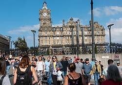 Busy pedestrian crossing in central Edinburgh, Scotland, UK