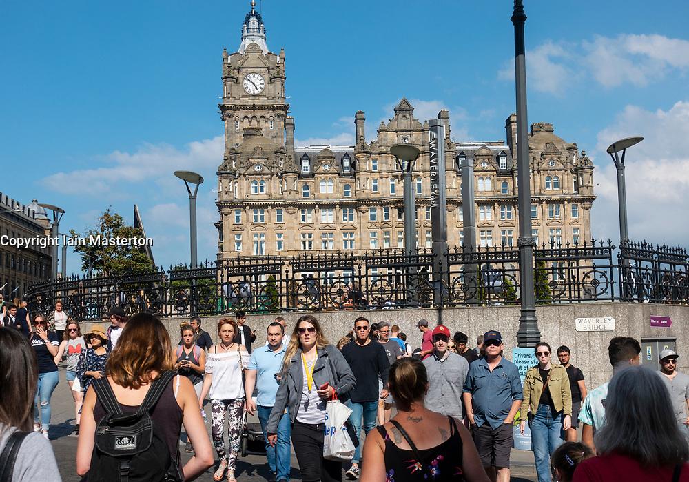 Busy pedestrian crossing in central Edinburgh, Scotland, UK