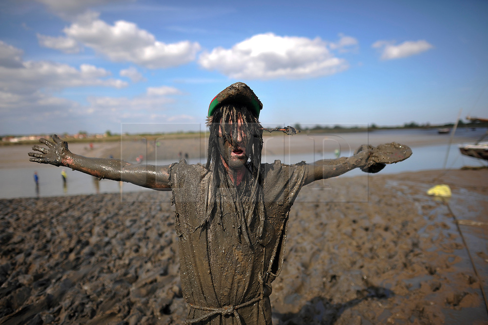 © London News Pictures. 05/05/2013. Malden, UK. A Competitor at the finish line of the Maldon Mud Race in Maldon, Essex on May 05, 2013. The race originated in 1973 and involves competitors racing around a course on the mudbanks of the river Blackwater at low tide. Photo credit: Ben Cawthra/LNP.