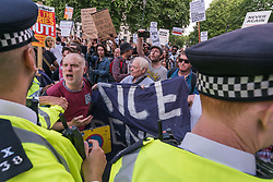 June 16, 2017 - London, UK - London, UK. 16th June 2017. Protesters argue with police at Downing St, and refusing to move to the pavement opposite held a noisy rally in front of the gates, with speakers from the North Kensington community, housing activists, residents from other tower blocks and Stand Up to Racism. They called for the resignation of Theresa May and her aide Gavin Barwell who as housing minister had failed to implement the changes in regulations recommended after the previous London tower block fire disaster. After a rally there they left to march for further protests at the BBC and elsewhere. Peter Marshall ImagesLive (Credit Image: © Peter Marshall/ImagesLive via ZUMA Wire)