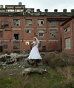 A bride poses at the Old Sugar Mill in Clarksburg, CA