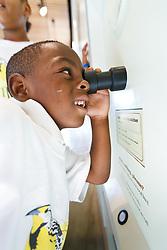 Children in nature education program exploring nature exhibits, Trinity River Audubon Center, Dallas, Texas, USA.