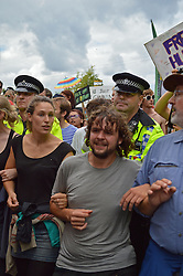© Licensed to London News Pictures. 18/08/2013. Balacombe, UK Balcombe, UK. Campaigners gather outside of the entrance to the Cuadrilla drilling site in Balcombe, West Sussex which has been earmarked for fracking. Cuadrilla has temporarily ceased drilling at the site under advice from the police after campaign group No Dash For Gas threatened a weekend of civil disobedience.  Photo credit : Aiden Jordan/LNP