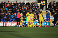 AFC Wimbledon defender Mads Bech Sorensen (26) and Fleetwood Town  defender Harry Souttar (6) both down with an injury during the EFL Sky Bet League 1 match between AFC Wimbledon and Fleetwood Town at the Cherry Red Records Stadium, Kingston, England on 8 February 2020.