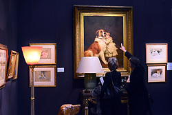 """© Licensed to London News Pictures. 18/03/2013. London, UK People look at """"Good Friends 1889"""" by Charles Burnton Barber with an estimated value of 80,000-120,000GBP. Press call for The Collection of Mark Birley at Sotheby's auction house today 18th March 2013. Mark Birley was the owners of members only clubs Annabel's, Mark's Club, George's Bar, Harry's Bar and The Bath and Racquets Club in London. Photo credit : Stephen Simpson/LNP"""