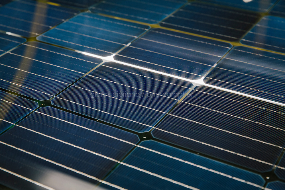 CATANIA, ITALY - 13 APRIL 2018: The new bifacial thin film solar panel is seen here at the visual inspection station during the testing phase at the 3Sun factory, the last European photovoltaic factory in Catania, Italy, on April 13th 2018..<br /> <br /> 3SUN is the last European photovoltaic factory which intends to compete with the most important worldwide companies in this sector. 3SUN is an industrial project that was founded in 2010 as a joint venture agreement between Enel Green Power, Sharp Corporation and STMicroelectronics. Since 2015 3Sun is entirely owned by Enel Green Power, the Italian multinational renewable-energy corporation.<br /> <br /> <br /> The 3SUN solar factory will produce bifacial thin film solar panel using heterojunction technology.<br /> The new panel marks a technological leap forward from the previous solution, based on the multi-junction of thin film silicon, to the production of new, cutting-edge bifacial photovoltaic modules using the heterojunction of amorphous and crystalline silicon (known as HJT).<br /> The new module will be exclusively produced in Catania and will guarantee a high performance in terms of efficiency and productivity, as well as a low degradation rate.