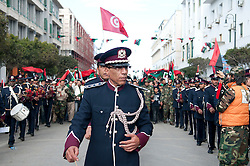© licensed to London News Pictures. TRIPOLI, LIBYA  17/02/12. Members of the Libyan Miltary Marching Band march through Martyrs' Square in Tripolil, Libya on the one year anniverary of Libya's revolution. Please see special instructions for usage rates. Photo credit should read MICHAEL GRAAE/LNP