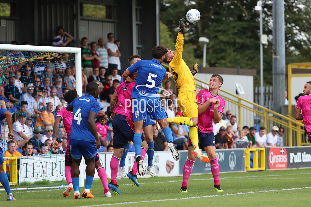 Queens Park Rangers goalkeeper Matt Ingram (18) beating AFC Wimbledon defender Will Nightingale (5) to the ball during the Pre-Season Friendly match between AFC Wimbledon and Queens Park Rangers at the Cherry Red Records Stadium, Kingston, England on 14 July 2018. Picture by Matthew Redman.