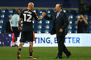 Rafa Benitez, the Newcastle United manager shakes hands with Jonjo Shelvey of Newcastle United after the final whistle. EFL Skybet football league championship match, Queens Park Rangers v Newcastle Utd at Loftus Road Stadium in London on Tuesday 13th September 2016.<br /> pic by John Patrick Fletcher, Andrew Orchard sports photography.