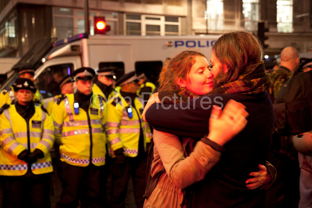 A couple embrace by police lines outside Panton House on Panton Street while being kettled. They were targeting Mick Davis, CEO of mining company Xstrata, which has offices in the building and is one of the highest paid from FTSE 100 companies.