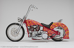 """""""Red Flame Chopper,"""" built by Arlen Ness from parts he had lying around his shop. The Chopper has easy to ride high bars with a 80-ci Shovelhead motor. Appears in book """"The King of Choppers,"""" by Michael Lichter and Arlen Ness and foreward by Sonny Barger"""