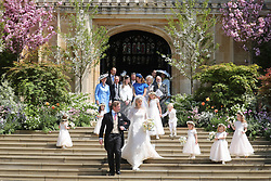 Newlyweds Thomas Kingston and Lady Gabriella Windsor walk down the steps of the chapel with their bridesmaids, page boys and guests after their wedding at St George's Chapel in Windsor Castle.