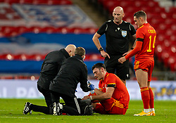 LONDON, ENGLAND - Thursday, October 8, 2020: Wales' Kieffer Moore on the floor with an injury to his left foot during the International Friendly match between England and Wales at Wembley Stadium. The game was played behind closed doors due to the UK Government's social distancing laws prohibiting supporters from attending events inside stadiums as a result of the Coronavirus Pandemic. England won 3-0. (Pic by David Rawcliffe/Propaganda)