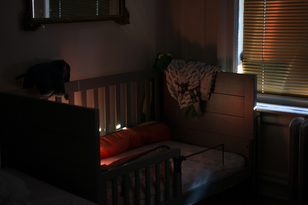 Morning light on Theodore's crib in our bedroom.