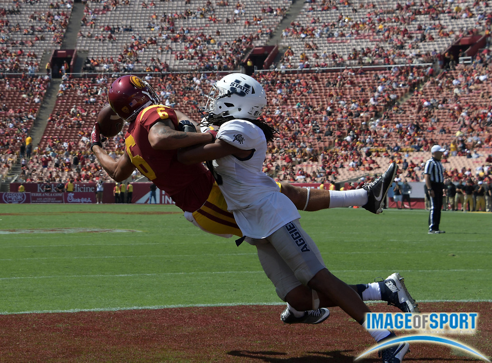 Sep 10, 2016; Los Angeles, CA, USA; USC Trojans wide receiver Michael Pittman Jr. (6) is defended by Utah State Aggies cornerback Wesley Bailey (8) during a NCAA football game at Los Angeles Memorial Coliseum. USC defeated Utah State 45-7.