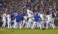 Oct 23, 2015; Kansas City, MO, USA; Kansas City Royals players celebrate on the field after defeating the Toronto Blue Jays in game six of the ALCS at Kauffman Stadium. Mandatory Credit: Peter G. Aiken-USA TODAY Sports