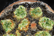 Vegetable patties being deep fried