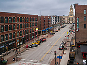 """24 MARCH 2020 - DES MOINES, IOWA: A deserted historic neighborhood in downtown Des Moines. Many of the city's residents chose to stay in their homes Tuesday. On Tuesday morning, 24 March, Iowa reported over 120 confirmed cases of the Coronavirus (SARS-CoV-2) and COVID-19. Restaurants, bars, movie theaters, places that draw crowds are closed for at least 30 days. The Governor has not ordered """"shelter in place""""  but several Mayors, including the Mayor of Des Moines, have asked residents to stay in their homes for all but the essential needs. People are being encouraged to practice """"social distancing"""" and many businesses are requiring or encouraging employees to telecommute.     PHOTO BY JACK KURTZ"""