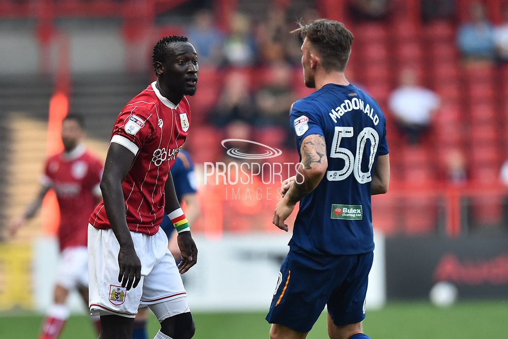 Famara Diedhiou (9) of Bristol City confronts Angus MacDonald (50) of Hull City during the EFL Sky Bet Championship match between Bristol City and Hull City at Ashton Gate, Bristol, England on 21 April 2018. Picture by Graham Hunt.