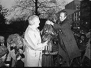 """Molly Malone Statue Unveiled. (R93)..1988..20.12.1988..12.20.1988..20th December 1988..""""Dublin's Fair City"""" received a millenniun gift to commemorate her most famous daughter, Molly Malone, when Jurys Hotel Group plc presented a specially commissioned sculpture to the people of Dublin. The sculpture was formally handed over by Michael McCarthy, MD,Jurys Hotel Group, to the Lord Mayor of Dublin, Councillor Ben Briscoe, TD, in an unveiling ceremony today at the corner of Grafton Street, Suffolk Street and Nassau Street..Molly Malone was created and fashioned in her traditional 17th century dress by Dublin born artist, Jeanne Rynhart, who was selected from a number of entries for the statue design, by the Dublin Millennium Board...Image shows Lord Mayor, Ben Briscoe giving Molly a hug as Michael McCarthy of Jurys Hotel looks on."""