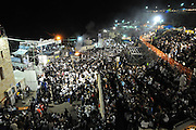 Jews praying during the lag baomer celebrations at mount Meron. Lag B'Omer is a day for bonfire celebrations. The most famous is held at the village of Meron, near the northern city of Safed.