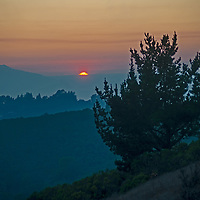 The sun sets over the California Coastal Mountains as seen from the Berkeley Hills in the San Francisco Bay Area.