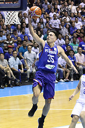 November 27, 2017 - Quezon City, NCR, Philippines - Matthew Wright (35) of the Philippines converts an uncontested lay-up against Chinese Taipei during their FIBA World Cup Qualifying Match..Gilas Pilipinas defeated the visiting Chinese Taipei team 90-83 to complete a sweep of their first two assignments in the FIBA 2019 World Cup qualifiers. (Credit Image: © Dennis Jerome S. Acosta/Pacific Press via ZUMA Wire)