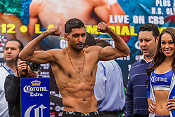 LOS ANGELES, CA - DEC 14: Former Unified Super Lightweight World Champion Amir ?King? Khan at the Khan vs Molina official weigh-in at the Los Angeles Sports Arena in Los Angeles, CA 2012/12/14. Byline, credit, TV usage, web usage or linkback must read . Byline and/or web usage link must  read PHOTO: © Eduardo E. Silva/SILVEX.PHOTOSHELTER.COM.