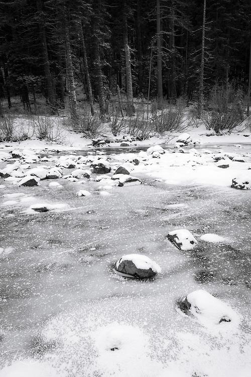 Frozen Truckee River in winter, Tahoe National Forest, California