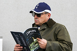 © Licensed to London News Pictures. 03/04/2019. London, UK. A Spurs fan reads the games brochure at the new £400 million stadium as Tottenham Hotspur's play their first competitive game against Crystal Palace this evening. Photo credit: Dinendra Haria/LNP
