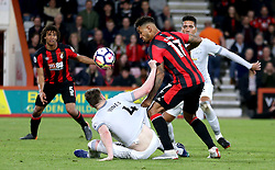 Manchester United's Phil Jones (floor) holds on to AFC Bournemouth's Joshua King inside the box whilst they battle for the ball