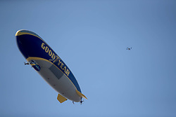 February 25, 2018 - Palm Beach Gardens, Florida, U.S. - The Goodyear blimp shares air space with a drone during the final round of the Honda Classic at PGA National Resort and Spa in Palm Beach Gardens, Florida on February 25, 2018. (Credit Image: © Allen Eyestone/The Palm Beach Post via ZUMA Wire)