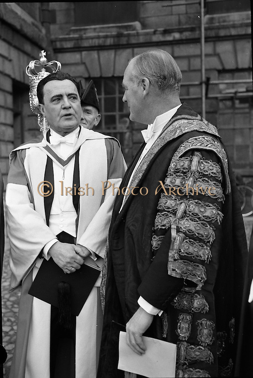 Michael MacLiammóir, author, poet, dramatist and painter, who recieved an honorary degree at Trinity College, Dublin, chatting with the Vice Chancellor, the Earl of Rosse, after the conferring..06.12.1962