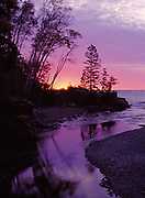 Sun rising over Lake Superior beyond the mouth of the Temperance River, Temperance River State Park, Minnesota.