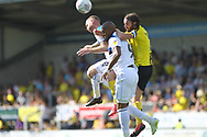 Calvin Andrew is squashed in a challenge during the EFL Sky Bet League 1 match between Burton Albion and Rochdale at the Pirelli Stadium, Burton upon Trent, England on 4 August 2018.