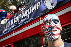 © Licensed to London News Pictures. 21/09/2016. London, UK. Campaign group Avaaz organise a 'Stop Trump' campaign bus to tour central London, rallying US expats to register to vote. The United States presendential election is scheduled for 8 November 2016. The Photo credit : Tom Nicholson/LNP